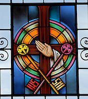 Stained glass image depicts the sacrament of holy orders. (Sam Lucero photo)