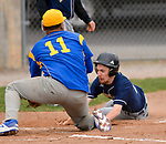 TORRINGTON, CT-042017JS08- Wolcott Tech's Tristan Sorenson (10) slides under the tag by Harding's Howard Stultz (11) to score on a passed ball during their game Wednesday at Fuessenich Park in Torrington. <br /> Jim Shannon Republican-American