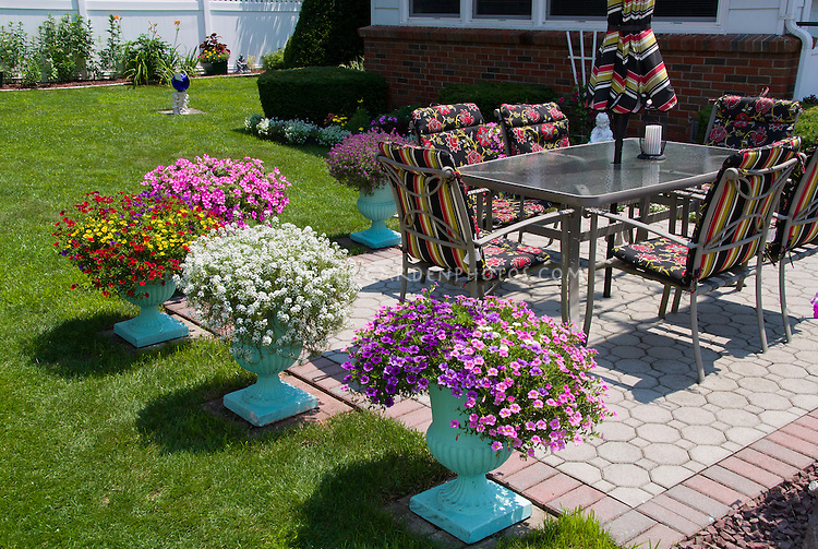 Pretty Container garden with pots around patio annual flowers lawn gras  garden furniture  Pretty patio. Flowering Patio Plants