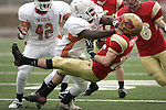 Jodi Miller Lubbock Avalanche-Journal..Arlington Bowie's Javayle Fields (64) flattens Coronado's Shanley Wilkinson (17) after a reception in the first quarter. Bowie won the Division 1 Regional Championship game 37-14.