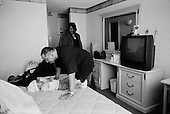 Cleveland, Ohio.March 26, 2008 ..After being evicted out of their apartment without notice, because the landlord foreclosed on the property they were renting, even though they had paid the rent, Darin Roseberry, 46 yrs old, and his two daughters, Ayuaunie, 17 months, and Denise 20 yrs, spent the night on a bus to keep warm. All of their belongings ended up on the street, and they ended up at Catholic Charities Emergency Assistance Services in Cleveland. Catholic Charities fed them and offered them a night in a hotel before they were spilt up and place in separate shelters, which tend to be over crowded and violent...Nicole Evans from the Catholic Charities sets them up in a hotel for the night.