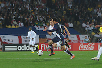 U.S. midfielder Landon Donovan races past England's Steven Gerrard during the teams' debut match in the 2010 FIFA World Cup. The U.S. and England played to a 1-1 draw in the opening match of Group C play at Rustenburg's Royal Bafokeng Stadium, Saturday, June 12th.