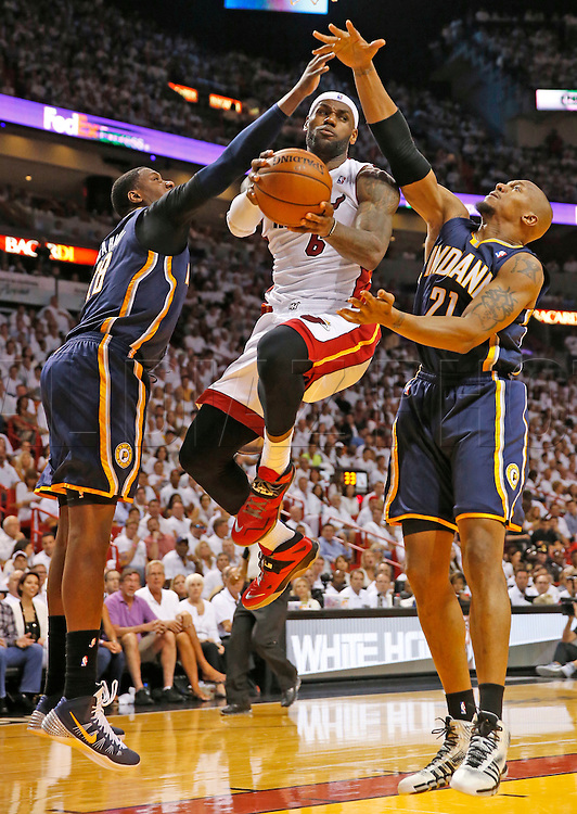 LeBron James looks to pass under the basket in the second quarter. The Miami Heat hosts the Indiana Pacers in game 4 at the AmericanAirlines Arena on Monday, May 26, 2014.