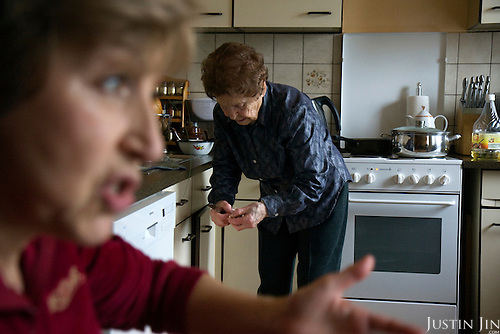 Ukrainian Jewish emigre Maria Tkach, 90, serves borscht at home in Berlin. Her daughter talks in the foreground. Borsht is a traditional Ukrainian cuisine that has spreaded via Russia throughout the former Soviet sphere.