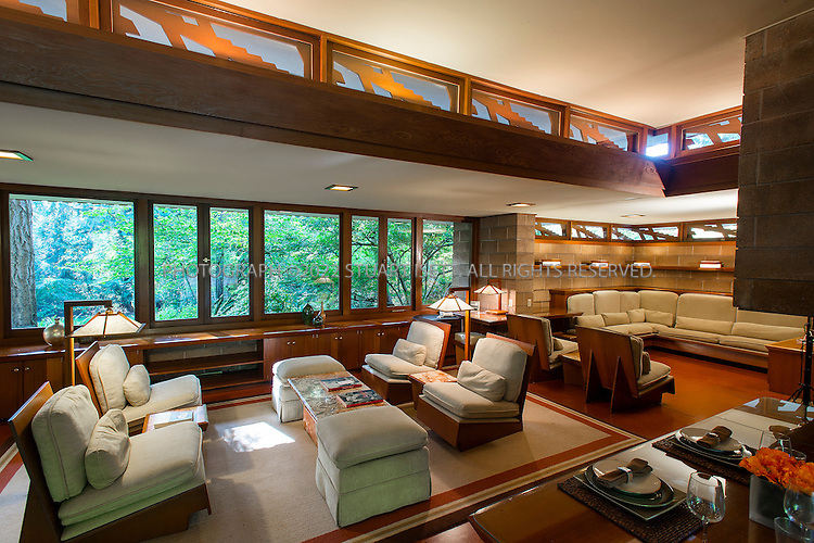 """10/9/2012--Sammamish, WA, USA..VIEW: Living room...Architect Frank Lloyd Wright planned his """"Usonian"""" homes to be affordable for middle-class families. The 1,9500 square foot Brandes home is for sale in Sammamish, Washington (30 minutes from Seattle) at $1.39 million. It features three bedrooms, two bathrooms and a small, separate office/study space...The home was built in 1952, and has redwood trim and Wright's original furniture and some garden sculptures by Wright. It's one of only three Frank Lloyd Wright homes near Seattle...©2012 Stuart Isett. All rights reserved."""