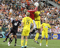 Bill Hamid #28 of D.C. United grabs the ball from Andy Iro #6 during an MLS match against the Columbus Crew at RFK Stadium on September 4 2010, in Washington DC. Columbus won 1-0.