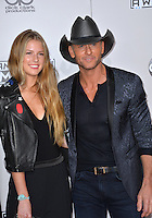 LOS ANGELES, CA. November 20, 2016: Country singer Tim McGraw &amp; daughter Maggie Elizabeth McGraw at the 2016 American Music Awards at the Microsoft Theatre, LA Live.<br /> Picture: Paul Smith/Featureflash/SilverHub 0208 004 5359/ 07711 972644 Editors@silverhubmedia.com