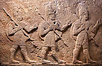 Image of Neo-Hittite orthostat with releif sculpture of 3 soldiers from the legend of Gilgamesh from Karkamis,, Turkey. Ancora Archaeological Museum.