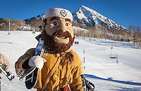 Mad Jack the Mountaineer, played by Ciera Glenn, unmasks after skiing with Santas at Crested Butte Mountain.