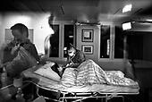 Wroclaw 02.02.2007 Poland.<br /> Rafal Kutyba, 12 in his room after operation with his mom.<br /> Clinical Hospital, oncology and haematology departmend. This is one of the important Haematologic Hospital in all over Poland, however hospital board stopped to discharge a rising debt. In this connection authorities must close hospital, but goverment had no idea what should do with terminaly ill children.<br /> (Photo: Adam Lach / Napo Images)<br /> <br /> Akedemicki Szpital Kliniczny, oddzial onkologii i hematologii. Temu jednemu z najwazniejszych w Polsce osrodkowi szpitalnemu grozi zamkniecie w powodu dlugow, ktore niezaleznie od wplat NFZ-tu regularnie sciaga komornik. Z calej Polski ludzie charytatywnie wplacaja pieniadze by uratowac szpital i los dzieci dla ktorych to miejsce jest jedynym ratunkiem.