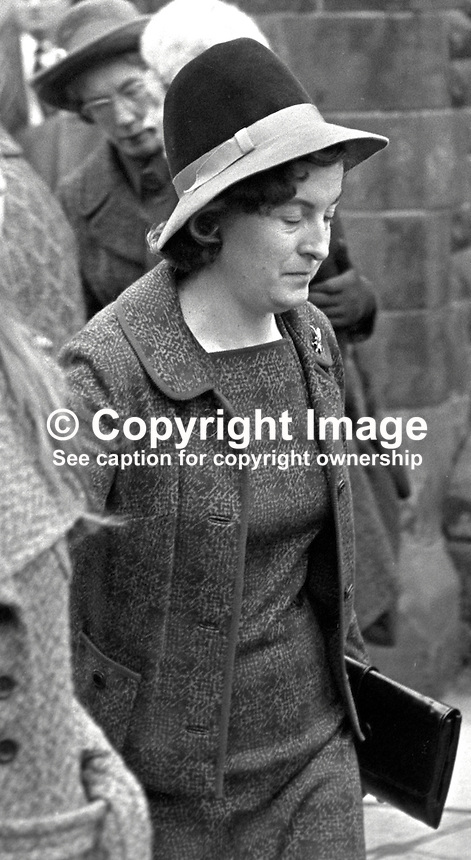 The widow of Sergeant George Coulter, RUC, leaves St Anne's Church of Ireland, Dungannon, N Ireland. The police patrol car in which Sgt Coulter was travelling was ambushed as it reached a road junction near the village of Donaghmore after it had been checking the home of a Nationalist MP who was under police guard. The attack was carried out by two members of the Provisional IRA using automatic weapons.  197502030062d..Copyright Image from Victor Patterson, 54 Dorchester Park, Belfast, UK, BT9 6RJ..Tel: +44 28 9066 1296.Mob: +44 7802 353836.Voicemail +44 20 8816 7153.Skype: victorpattersonbelfast.Email: victorpatterson@me.com.Email: victorpatterson@ireland.com (back-up)..IMPORTANT: If you wish to use this image or any other of my images please go to www.victorpatterson.com and click on the Terms & Conditions. Then contact me by email or phone with the reference number(s) of the image(s) concerned.