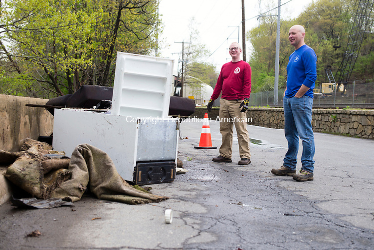 Waterbury, CT- 06 May 2017-050617CM05-  Volunteers Will Wesson, left, vice president at Wesson Energy and Jim O'Rourke, executive director at the Greater Waterbury YMCA talk about some of the debris, including an refrigerator, they pulled from the Naugatuck River on Saturday. The Waterbury Greenway Advisory Committee and volunteers spent the morning cleaning up along Municipal Road.   Christopher Massa Republican-American