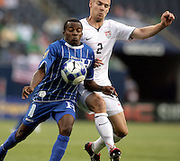 Heath Pearce (2) pressures Marvin Chavez (10).  The US Men's National Team defeated Honduras 2-0 in the semifinals of the Gold Cup at Soldier Field in Chicago, IL on July 23, 2009.