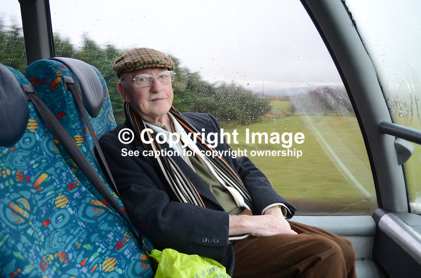 Ken Lavery, former Belfast Telegraph press photographer, photographed in bus travelling to Londonderry. 201212041030..Copyright Image from Victor Patterson, 54 Dorchester Park, Belfast, UK, BT9 6RJ..Tel: +44 28 9066 1296.Mob: +44 7802 353836.Voicemail +44 20 8816 7153.Skype: victorpattersonbelfast.Email: victorpatterson@me.com.Email: victorpatterson@ireland.com (back-up)..IMPORTANT: If you wish to use this image or any other of my images please go to www.victorpatterson.com and click on the Terms & Conditions. Then contact me by email or phone with the reference number(s) of the image(s) concerned.