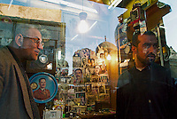Baghdad, Iraq Feb 14, 2003.A watchmaker shop in Rashid street is decorated with Panarabic political memorablia: Nasser, Qassim, King Hussein, Saddam Hussein are represented amongst other popular figures such as singers, poets and actors.