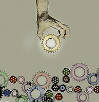 Hand choosing gold cog from assorted multicoloured cogs