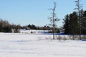Winter scenic, sugar cabin beside snow covered frozen  lake