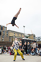 London, UK. 29.09.2013. Cirque Eloize performs for the Sunday crowds in Ely's Yard, outside the Truman Brewery, East London, prior to their show, iD, opening at the Peacock Theatre on Tuesday 1st October, running to Saturday 19th October. Canadian circus troupe Cirque &Eacute;loize have become world leaders in contemporary circus since the company was founded in 1993.  Cirque &Eacute;loize specialises in creating shows that fuse circus arts with music, theatre and dance. Directed by Jeannot Painchaud, Cirque &Eacute;loize will bring iD &ndash; an exciting family friendly production, blending circus, street dance and hip hop to the Peacock Theatre from Tuesday 1 October  - Saturday 19 October.<br /> <br /> iD  takes the audience through the heart of a futuristic city which fuses the aesthetics of comic book art, B-Movie science fiction and the rich artistic world of graffiti art. Photograph &copy; Jane Hobson.