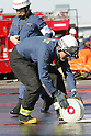 TOKYO - JANUARY 06: Firefighter demonstrates rescue operations during the New Year's fire review conducted by the Tokyo Fire Department at Tokyo Big Sight on January 6, 2010 in Tokyo, Japan. The annual event, featuring various demonstrations of the latest firefighting and emergency rescue techniques, aims to promote the prevention of fire and disaster. About 2,700 professional firefighters and members of community-based fire companies in Tokyo and 137 fire vehicles, helicopters and ships were mobilized for the annual demonstration. (Photo by Laurent Benchana/Nippon News)