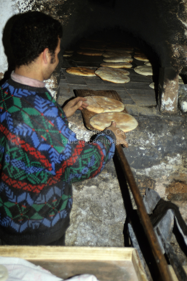 Fez, Morocco - A Baker Removes Baked Bread from his Oven.
