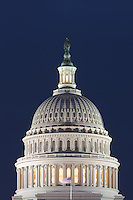 Lights illuminate the US Capitol Building after sunset in Washington DC