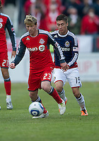 02 April 2011: Toronto FC midfielder Jacob Peterson #23 and Chivas USA defender/midfielder Jorge Flores #19 in action during an MLS game between Chivas USA and the Toronto FC at BMO Field in Toronto, Ontario Canada..The game ended in a 1-1 draw...