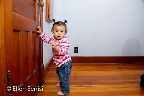 MR / Schenectady, NY. Portrait of infant (girl, 12 months, African American & Caucasian) standing by door. MR: Dal4. ID: AL-HD. © Ellen B. Senisi (Ellen B. Senisi)