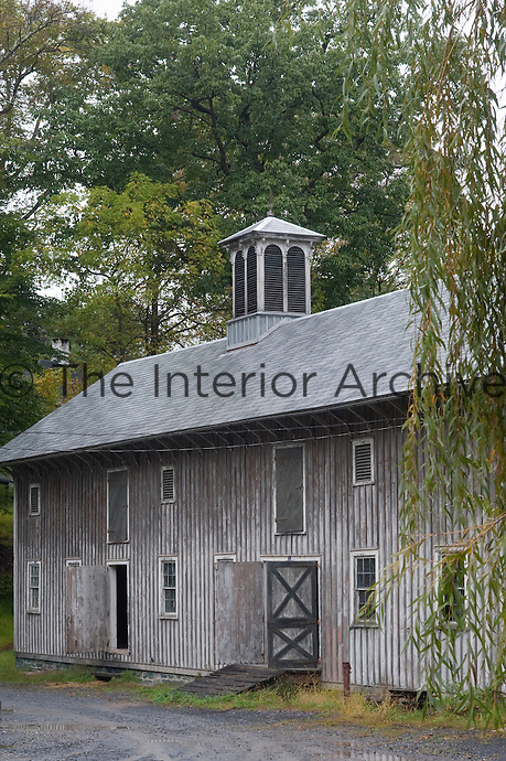 Mature trees surrounding the collection of barns testify to the age of the estate