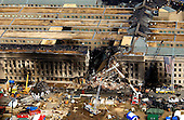 Federal Bureau of Investigation (FBI) agents, fire fighters, rescue workers and engineers work at the Pentagon crash site on Friday, September 14, 2001, where a hi-jacked American Airlines flight slammed into the building on September 11, 2001.  The terrorist attack caused extensive damage to the west face of the building and followed similar attacks on the twin towers of the World Trade Center in New York City.  .Credit: Department of Defense via CNP.
