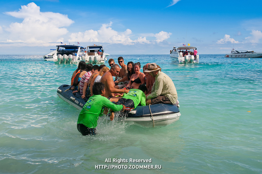 Tourists leaving Ko Miang on inflatable boa, Similan islands, Thailand