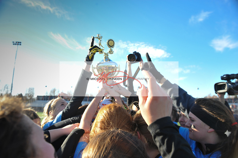 The trophy is lifted following the state championship game at West High Saturday, October 15, 2016.  Photo for the Star by Michael Dinneen