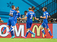 Mario Balotelli of Italy celebrates scoring a goal with team mates after making it 1-2
