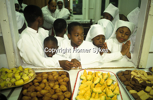 Brotherhood of the Cross and Star London.  South London. The Sunday service day of prayer goes on all day with various breaks. This is the lunch time break. from A STORM IS PASSING OVER a Look at Black Churches in Britain. Published by Thames and Hudson isbn 0 500 27826 1