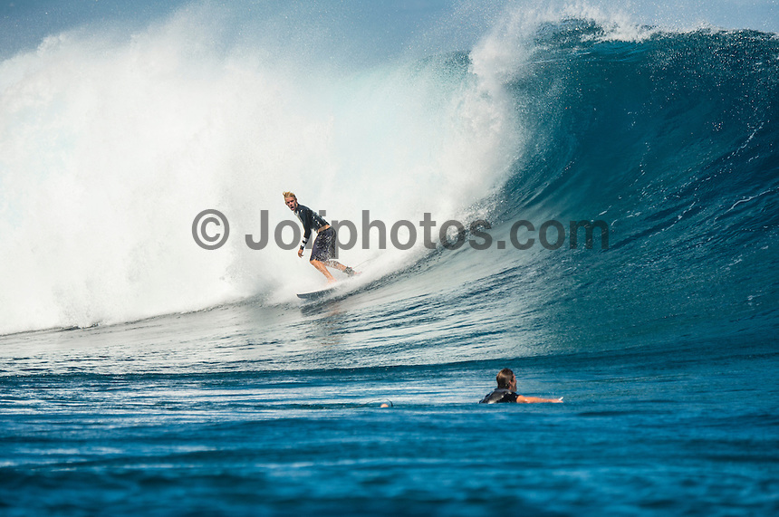 Namotu Island Resort/Fiji (Sunday, September 8, 2013) - John John Florence (HAW). Koa Smith (HAW) and Nathan Florence (HAW) at Cloudbreak. The swell is in the 6' with Cloudbreak being the prime spot. The wind has finally mellowed and turned back to Trades which is offshore at most of the breaks. Namotu Lefts and Swimming Pools also had waves today.  Photo: joliphotos.com
