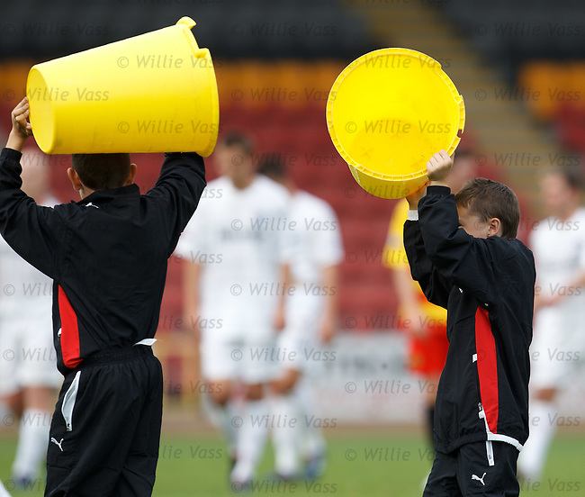 Partick ballboys take their bucket seats away at the end.   Jings Crivvens...