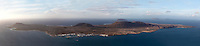Panoramic view of La Graciosa Island, off Lanzarote, Canary Islands, Spain, pictured on November 26, 2010 in the evening. The view is seen from Mirador del Rio, famous clifftop viewing point. Lanzarote, the Easternmost of the Canary Islands, lies 125km East of the African coast, in the Atlantic Ocean. Like the other islands in this autonomous Spanish archipelago, Lanzarote is originally Volcanic. Picture by Manuel Cohen.