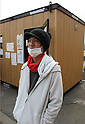 "March 30, 2011, Ishinomaki, Miyagi, Japan - More than two weeks after the tsunami, volunteer groups look to contribute to the relief effort. Hiroyuki Kobayashi, 18, is on spring break before he starts college. He rode his bike for a week from Aichi Prefecture to come and volunteer. He just checked in at the volunteer office behind him. ""I just couldn't stay at home and watch on TV."" (Photo by Wesley Cheek/AFLO) [3682]."