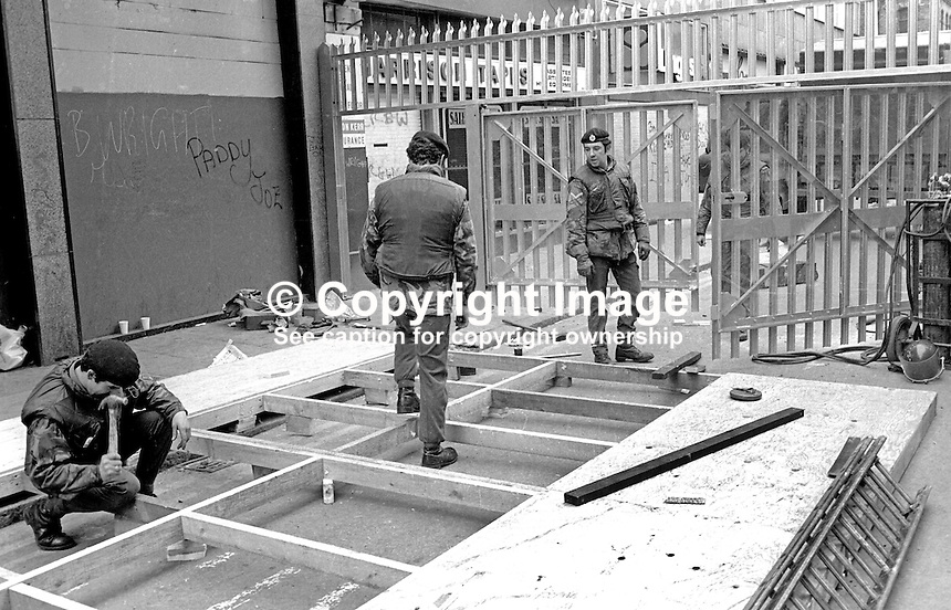 British soldiers spend Sunday 28th March 1976 erecting new security barriers in the main shopping area of Belfast, N Ireland, UK. 197603280169a<br />