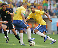 Adriano (7) of Brazil looks for a pass from Ronaldo (9). Brazil defeated Australia, 2-0, in their FIFA World Cup Group F match at the FIFA World Cup Stadium, Munich, Germany, June 18, 2006.