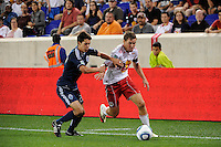 Chris Albright (3) of the New York Red Bulls is marked by Shea Salinas (22) of the Vancouver Whitecaps. The New York Red Bulls and the Vancouver Whitecaps played to a 1-1 tie during a Major League Soccer (MLS) match at Red Bull Arena in Harrison, NJ, on September 10, 2011.