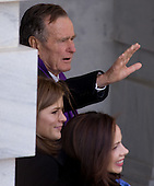 Washington, DC - January 20, 2009 -- Former United States President George H.W. Bush arrives alongside his granddaughters, Barbara Bush and Jenna Bush, at the US Capitol for the swearing in of Barack Obama as the 44th US president in Washington, DC, on January 20, 2009. .Credit: Saul Loeb - Pool via CNP