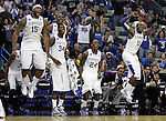 Starting players on the bench celebrate after Mark Krebs makes a three pointer during the second half of UK's second round  win, 90-60 over Wake Forest in the NCAA tournament at New Orleans Arena on Saturday, March 20, 2010. Photo by Britney McIntosh | Staff