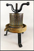 BNPS.co.uk (01202 558833)<br /> Pic: Golding,Young&amp;Mawer/BNPS<br /> <br /> An unusual late 19thC iron and tin fruit press.<br /> <br /> A collection of quirky 100-year-old kitchen gadgets designed to make life easier for the Mary Berry of Victorian days have emerged for sale.<br /> <br /> Long before Kenwood Chef and KitchenAid were the must-have items, these unusual tools - which include mincers, chopping devices and a butter churn - were the forerunners.<br /> <br /> Unlike their popular modern counterparts, many of the tools were too expensive for most people to buy and were not highly reliable and so are rarely found today.<br /> <br /> The 25 kitchen items, which date from the late 19th and early 20th century, are being sold by Golding, Young &amp; Mawer auctionhouse and are expected to fetch thousands of pounds.