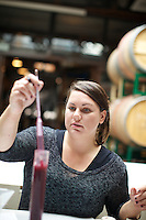 BROOKLYN, NY - NOVEMBER 1, 2013: An intern at Williamsburg's Brooklyn Winery checks the acidity of the juice of recently crushed grapes. <br /> <br /> <br /> &copy; Clay Williams / http://claywilliamsphoto.com