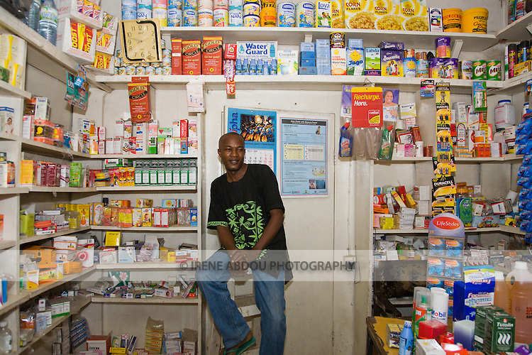 A proprietary patent medicine vendor (PPMV) in the Dakata area of Kano, Nigeria, displays Gold Circle and Lifestyles condoms, Waterguard - a chlorine product that makes water safe to drink - and malaria treatment drugs on it shelves. These products are distributed by the Society for Family Health (SFH), Nigeria's largest indigenous non-profit and affiliate of the international social marketing organization, Population Services International (PSI).  To the right of the shopkeeper is a malaria treatment job aid developed and produced by SFH, with USAID funding.