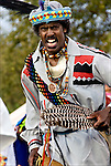 Lonnie Harrington, Seminole Native and African American dancer in traditional regalia.<br /> Inter-Tribal Dancing a celebration of ethnic Native American pride and heritage at Thunderbird Pow Wow in Queens NY.<br /> <br /> A pow-wow (also powwow or pow wow or pau wau) is a gathering of North America's Native people. The word derives from the Narragansett word powwaw, meaning &quot;spiritual leader&quot;.