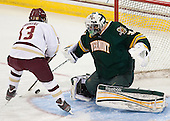 Johnny Gaudreau (BC - 13), Brody Hoffman (UVM - 37) - The Boston College Eagles defeated the University of Vermont Catamounts 4-1 on Friday, February 1, 2013, at Kelley Rink in Conte Forum in Chestnut Hill, Massachusetts.