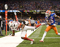 DeVante Parker of Louisville scores a touchdown during 79th Sugar Bowl game against Florida at Mercedes-Benz Superdome in New Orleans, Louisiana on January 2nd, 2013.   Louisville Cardinals defeated Florida Gators, 33-23.