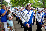 Duke's marching band begins the Blue Devil walk as fans line up to cheer on the team. Duke faculty and staff helped cheer on the Blue Devils during the Employee Kickoff Celebration and season opener against North Carolina Central University. Duke won the game 49-6 at the newly renovated Brooks Field at Wallace Wade Stadium.