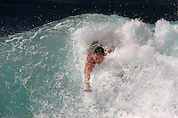 Bodysurfer taking on a wave at Point Panic, one of the most challenging bodysurfing spots on Oahu.
